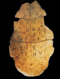 A bottom tortoise shell used in divination known as platromancy