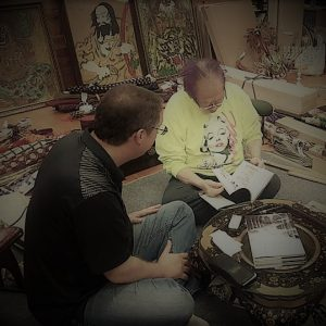 The author, Sean Askew, discussing the history of the Momochi-Den with Grandmaster Masaaki Hatsumi